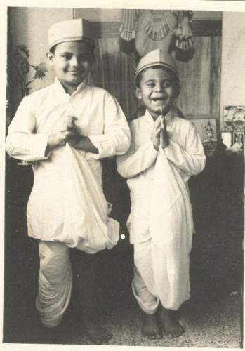 Dressed in the traditional attire of a cloth merchants. The family business was cloth hence the name Kapadia.Lt. Nawang is to the right in both the pictures