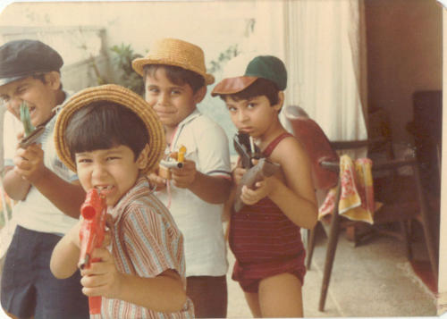 Holding guns from a young age...though they were only water guns then. Nawang is second from the right